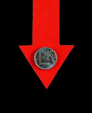 slump: Red Arrow with Russian Ruble Down on the Black Background Stock Photo