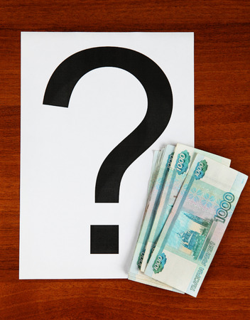 ques: Russian Currency and Question Mark on the Wooden Background
