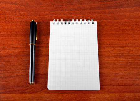 writing pad: Blank Writing Pad and Pen on The Table