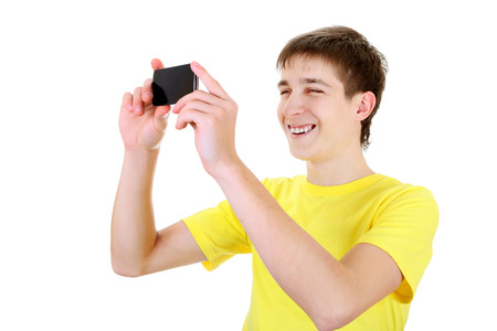 Teenager Take a Picture with a Cellphone on the White Background Stock Photo