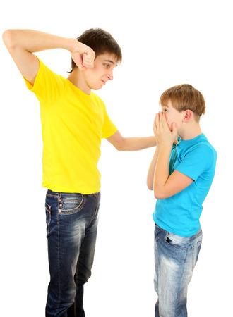 threaten: Teenager threaten a Kid on the White Background