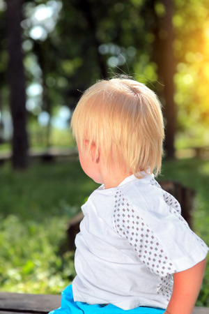 turn away: Child look away at the Summer Park
