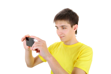 gladden: Teenager Take a Picture with a Cellphone on the White Background Stock Photo