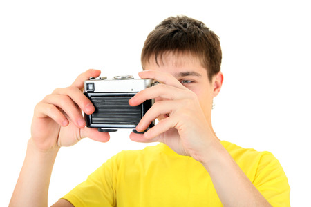 gladden: Teenager take a Self Portrait with Vintage Photo Camera on the White Background