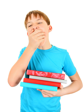 wearied: Bored Kid with the Books Isolated on the White Background
