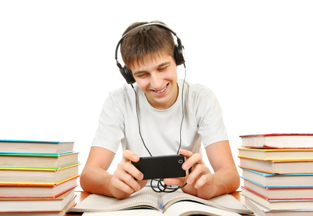 slacker: Cheerful Student listen the Music with the Books on the White Background