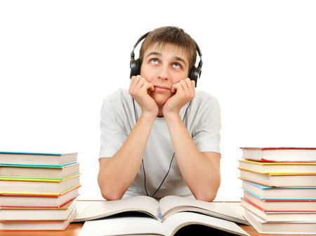 ennui: Bored Student in Headphones with the Books on the White Background