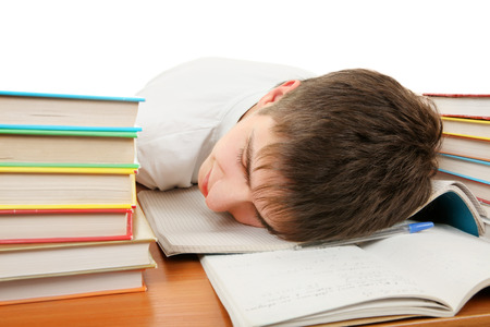 drowse: Tired Student sleep on the School Desk on the White Background