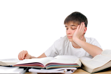 wearied: Tired and Bored Student on the School Desk Isolated on the White Background