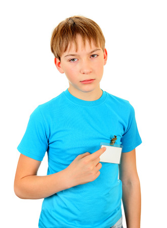 Sad Kid with the Empty Badge on t-shirt Isolated on the White Background Stock Photo