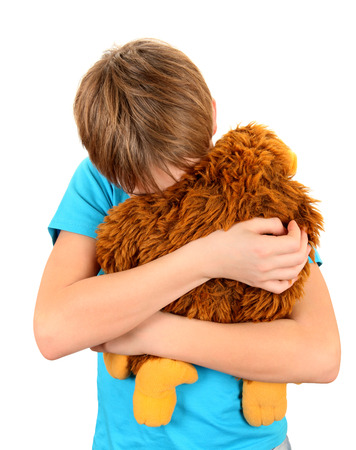 tearful: Sad Kid with Plush Toy on the White Background