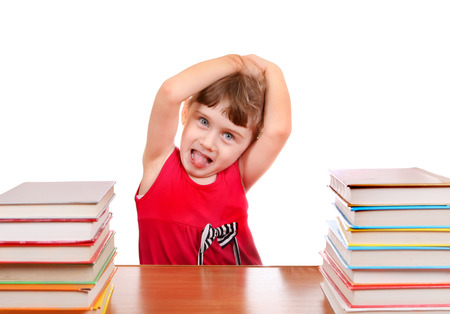 unruly: Naughty Little Girl with the Book at the Desk on the White Background