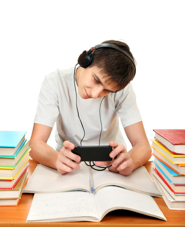 slacker: Student listen the Music with the Books on the White Background