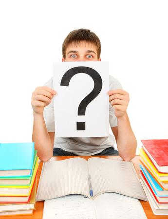 point d interrogation: �tudiant Question Mark avec les livres sur le fond blanc