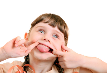 sincere girl: Cheerful Little Girl make a Funny Face on the White Background