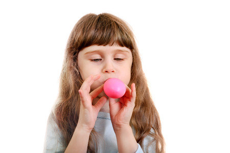 inflate: Little Girl inflate a Pink Balloon on the White Background Stock Photo