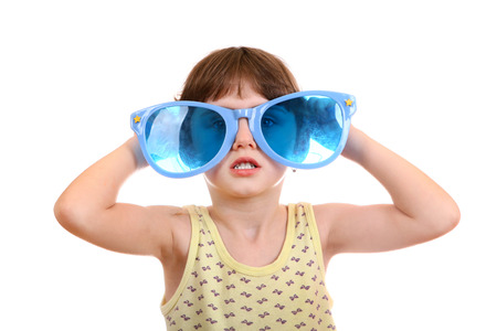 Little Girl with Big Blue Glasses Isolated on the White Background photo