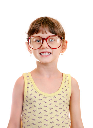 shortsightedness: Little Girl in the Glasses Isolated on the White Background