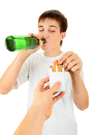 allurement: Young Man with a Beer take a Cigarette on the White Background Stock Photo