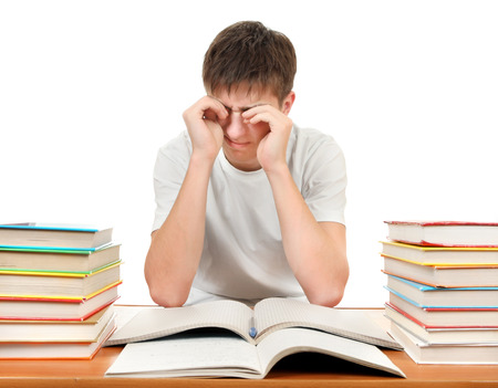 jaded: Tired Student at the School Desk Isolated on the White Stock Photo