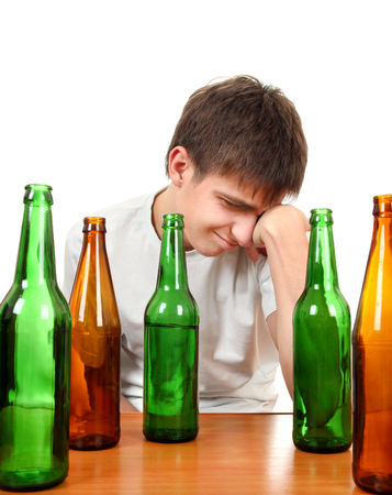 intoxicating: Sad Young Man in Alcohol Addiction on the White Background Stock Photo