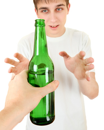 allurement: Teenager take a Beer Isolated on the White Background Stock Photo