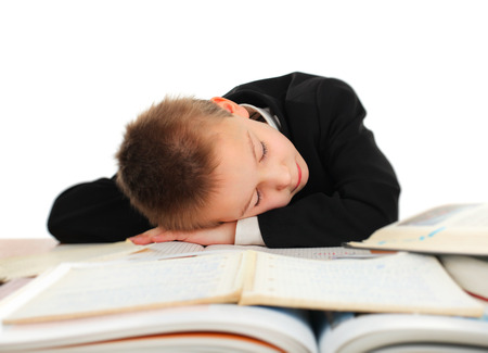 drowse: Tired Schoolboy sleep on the Books on the White Background