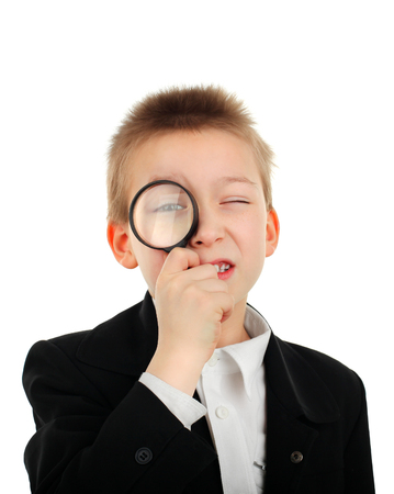 boyhood: Kid with Magnifying Lens on the White Background