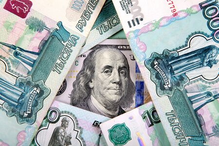 roubles: American Dollars on the Russian Roubles Background Stock Photo