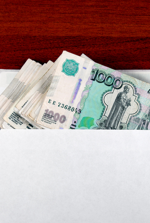 venality: Russian Rubles in Envelope on the Table closeup