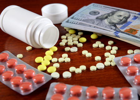 American Dollars and Medical Supplies on the Table