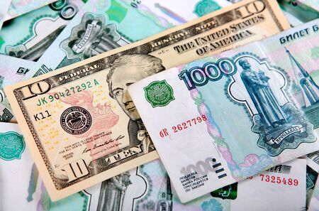 roubles: American Dollars on the Russian Roubles closeup Stock Photo