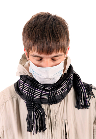 grippe: Young Man in Flu Mask Isolated on the White Background