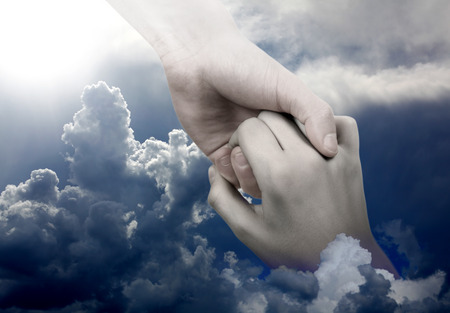 help: Helping Hand reaching for Help on the Sky Background Stock Photo
