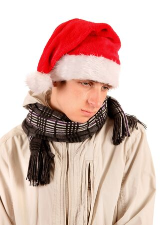 expulsion: Sad Young Man Portrait in Santas Hat Isolated On The White Background