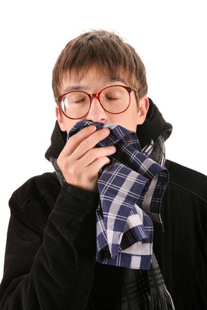 hanky: Sick Teenager in the Coat with Handkerchief Isolated on the White Background