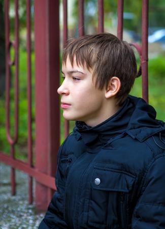 boyhood: Pensive Kid Portrait on the City Street