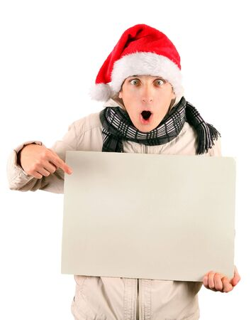 topcoat: Surprised Young Man in Santas Hat with Blank Board Isolated On The White Background