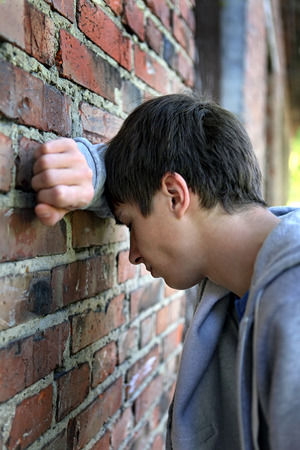 heartsick: Sad Young Man by the Old Brick Wall