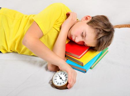 reveille: Kid sleep with Alarm Clock on the Books