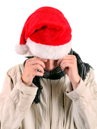 downcast: Sad Young Man in Santas Hat Isolated On The White Background