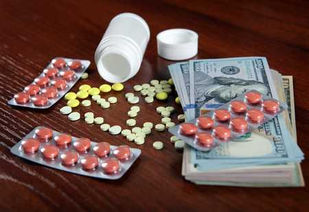 American Dollars and Pills on the Table closeup