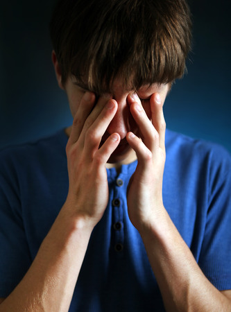 tearful: Sad and Tearful Man in the Dark Room