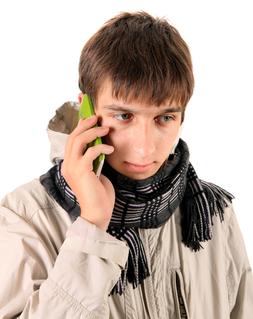 topcoat: Young Man with Cellphone Isolated on the White Background