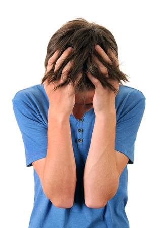 heartsick: Stressed Young Man Isolated on the White Background