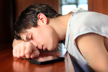 fatigued: Young Man sleep on the Table in the Room closeup