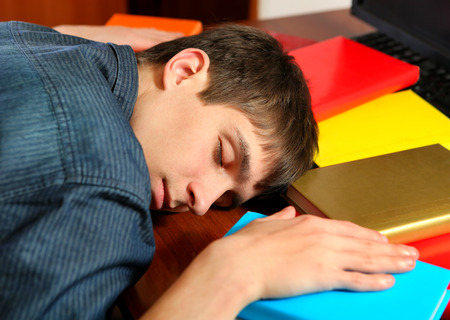 bibliophile: Tired Young Man sleep on the Books at the Home Stock Photo