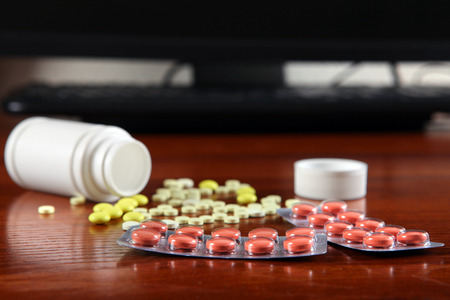 somnolent: Pills on the Table at the Home closeup