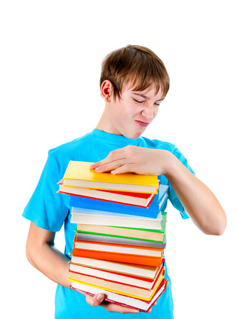 displeased: Displeased Teenager with the Books Isolated on the White Background