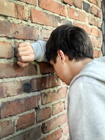 heartsick: Sad Young Man by the Old Brick Wall